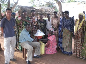 Benjamin Hans speaks with village leaders to a community about chlorine dispensers in Iganga, Uganda.