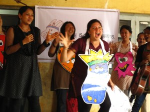 """Lisa playing the """"germ king"""" in a production of Hath Mein Sehat's health and hygiene education program at a primary school performance in Hubli, Karnataka."""