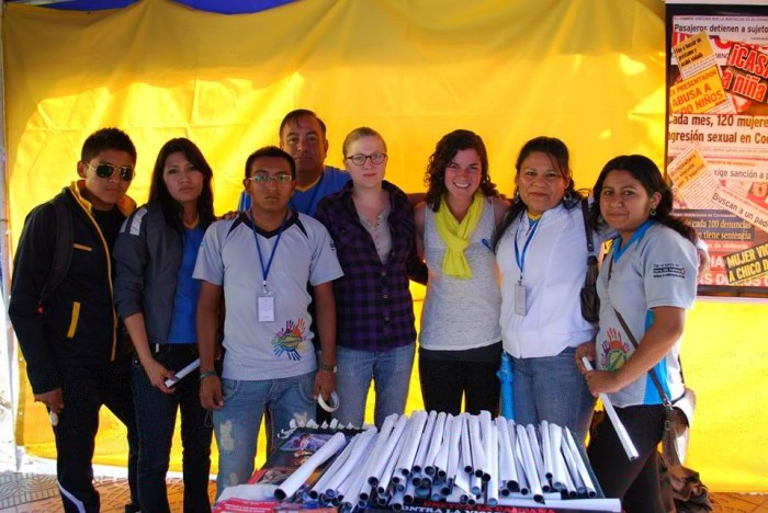 Hinman's GPP practice experience at the Instituto Para el Desarollo Humano in Cochabamba, Bolivia, challenged her assumptions about development work. She appears here with her Bolivian coworkers at a Sexual Violence Prevention fair.