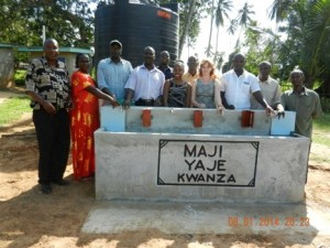 Celebrating accomplishment. Ashley Miller with Maji Yaje Kwanza community leaders at the new community water kiosk.