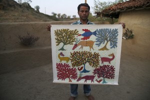 An artisan from Madhya Pradesh who specializes in the traditional art form of Gond painting showcases his work.