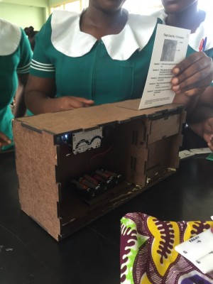 A group of Ghanaian women undergoing training with the use of a box that serves as a replica for the VIA training simulator.