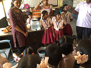 A teacher explains the importance of hand washing to elementary school students in Chennai. © Hygiene Heroes, 2015